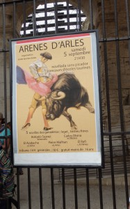 BULLFIGHT POSTER  Provencal-style bullfights still take place in the Roman Amphitheatre. Athletic men attempt to remove ribbons and a tassel from the animal's horns, hoping to avoid getting gored. Happily, the bull isn't killed or hurt as in the Spanish variety.